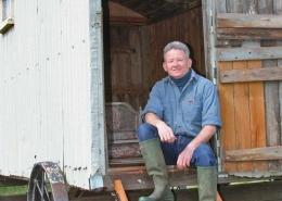 David Morris at the door of a shepherd's hut