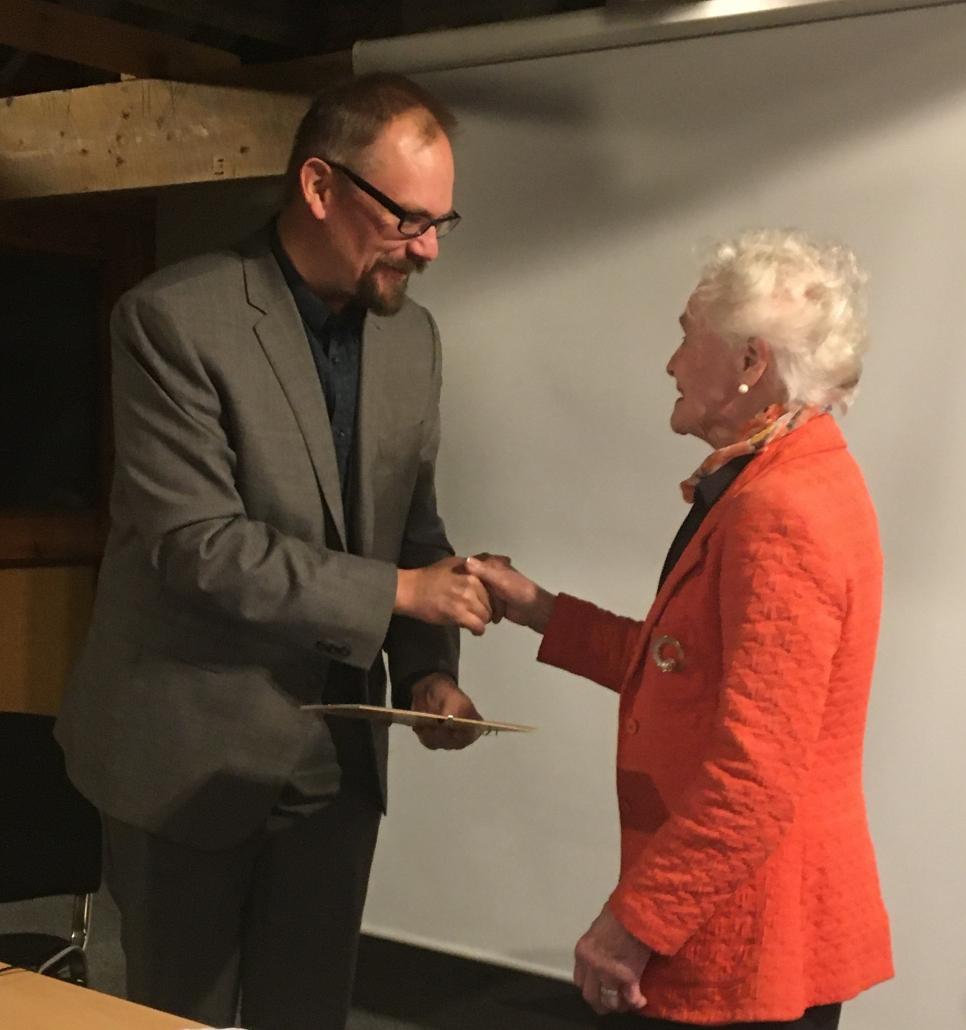 Jill Sumner receives her Volunteer of the Year Award from DMA Chair Jon Murden
